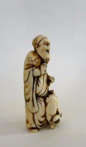 Antiquités - Netsuke, An old man and his dog, Japan Edo (1603-1868)