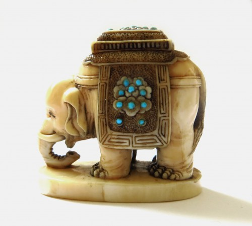 Netsuke Elephant on marine ivory standing. Japan Edo