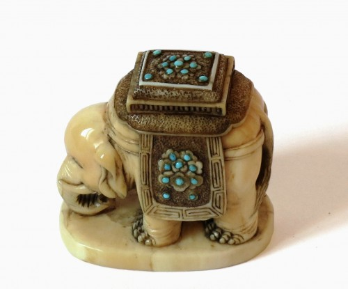 Asian Art & Antiques  - Netsuke Elephant on marine ivory standing. Japan Edo