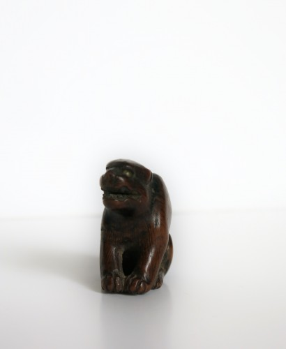 Asian Art & Antiques  - NETSUKE – A wood model of a tiger