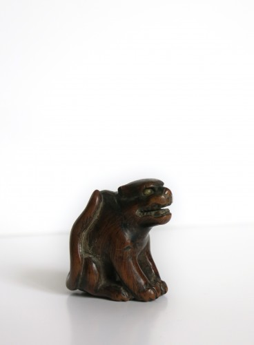 - NETSUKE – A wood model of a tiger