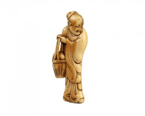 NETSUKE – Chinese woman carrying a fruit basket
