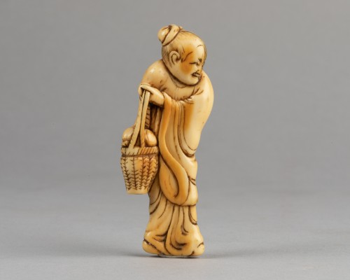 Asian Works of Art  - NETSUKE – Chinese woman carrying a fruit basket