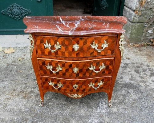 Chest of drawers form tomb, curved front and sides.