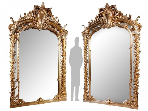 Monumental pair of giltwood mirrors