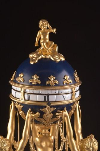 The 3 Graces, an impressive Cercle Tournant mantel clock  -