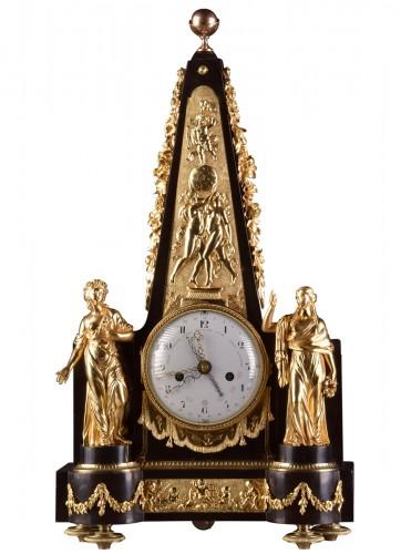 A large rare Obelisk Mantel clock with calendar. Late 18th c