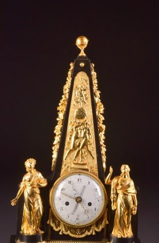 Horology  - A large rare Obelisk Mantel clock with calendar. Late 18th c