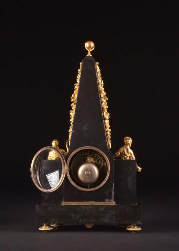 A large rare Obelisk Mantel clock with calendar. Late 18th c -