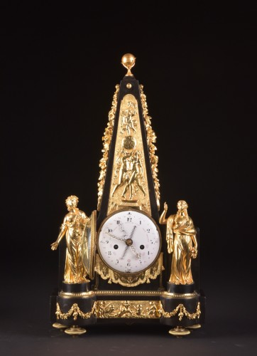 Louis XVI - A large rare Obelisk Mantel clock with calendar. Late 18th c