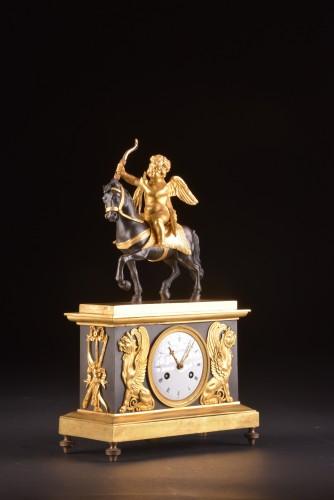 18th century - Cupid on horseback, a Directoire ormolu mantel clock