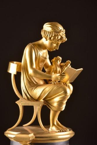 "Horology  - A beautiful bronze gilt & patinated ""Child reading"" Empire clock, ca. 1810"