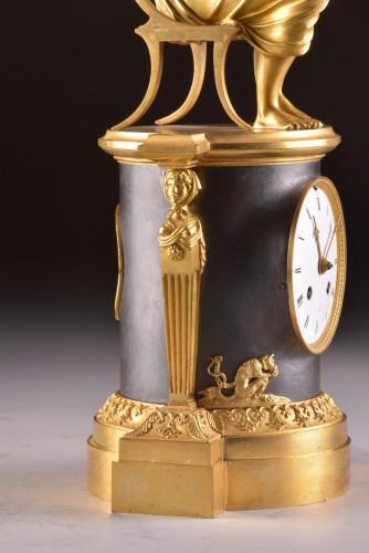 "A beautiful bronze gilt & patinated ""Child reading"" Empire clock, ca. 1810 -"