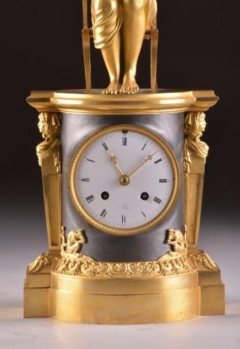 "19th century - A beautiful bronze gilt & patinated ""Child reading"" Empire clock, ca. 1810"
