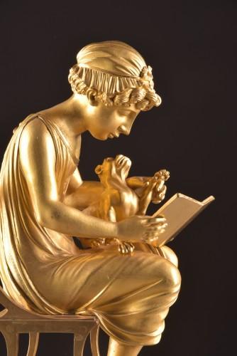 "A beautiful bronze gilt & patinated ""Child reading"" Empire clock, ca. 1810 - Empire"