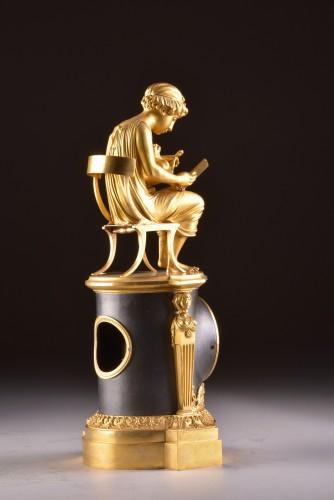"Empire - A beautiful bronze gilt & patinated ""Child reading"" Empire clock, ca. 1810"
