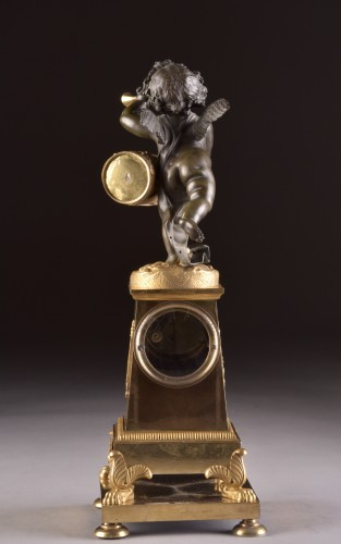 """Antiquités - High qualiy French Empire clock """"Putto with drum and flute"""""""