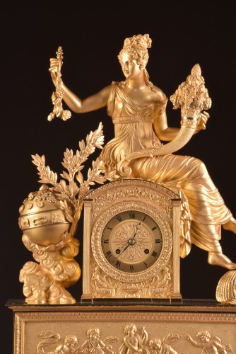 Horology  - A large French gilt bronze pendule, Fortuna Goddess with the Cornucopia
