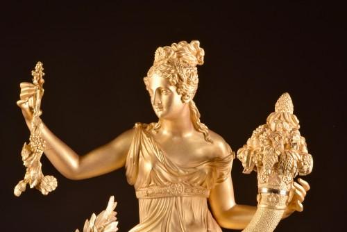 A large French gilt bronze pendule, Fortuna Goddess with the Cornucopia  -