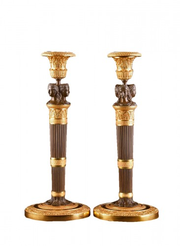 Claude Galle, Pair of gilt & patinated bronze candlesticks