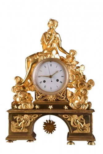 A large romantic Directoire pendule with pinnen wheel