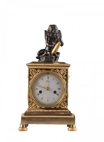A French Empire mantel clock with putti