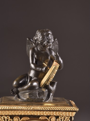 A French Empire mantel clock with putti  - Horology Style Empire