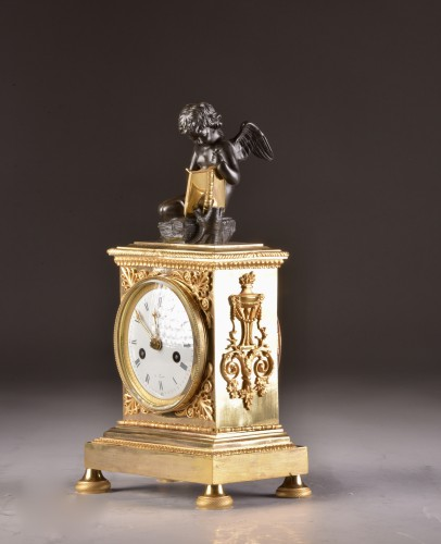 Horology  - A French Empire mantel clock with putti