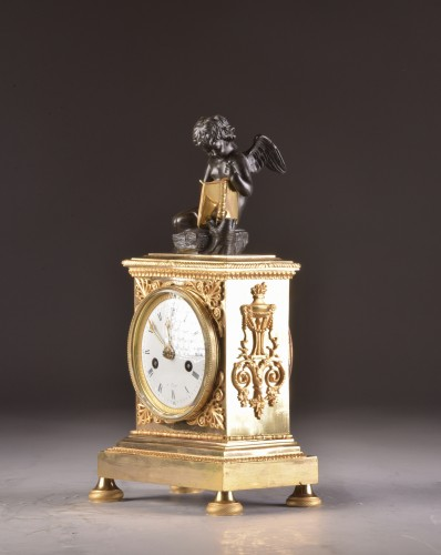 A French Empire mantel clock with putti  -