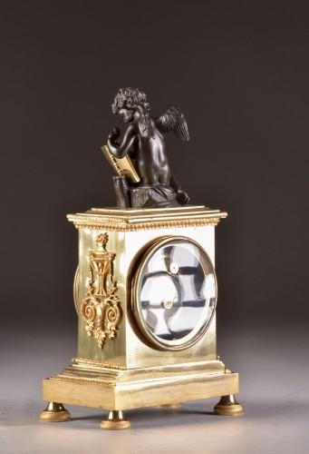 A French Empire mantel clock with putti  - Empire