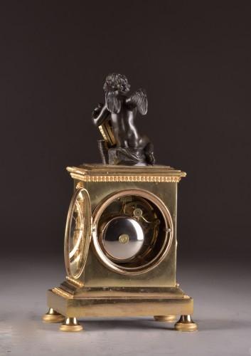 Empire - A French Empire mantel clock with putti