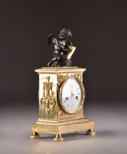 Antiquités - A French Empire mantel clock with putti