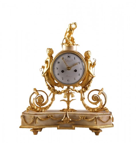 A beautiful marble Louis XVI mantel clock with mermaid and bacchante
