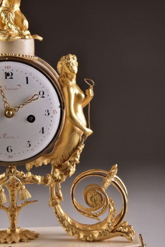 A beautiful marble Louis XVI mantel clock with mermaid and bacchante -