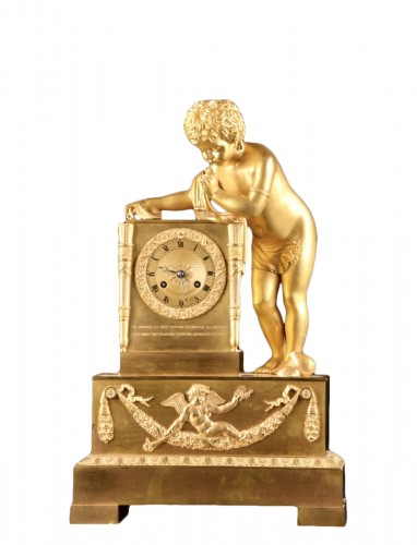 A French Louis Philippe mantel clock with a large putto, circa 1830