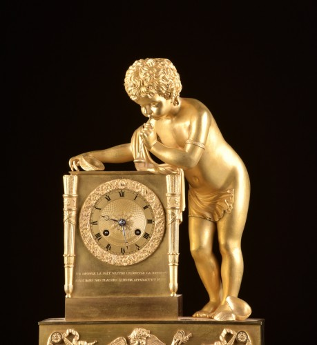 A French Louis Philippe mantel clock with a large putto, circa 1830 - Horology Style Louis-Philippe