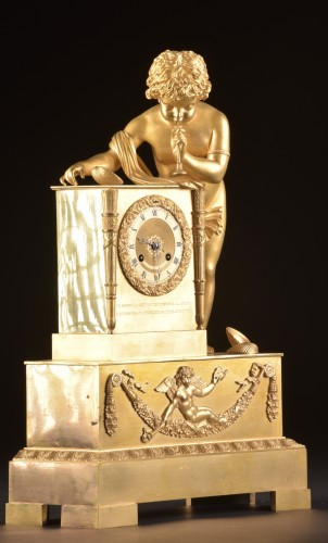 Horology  - A French Louis Philippe mantel clock with a large putto, circa 1830