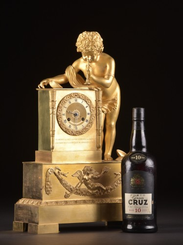 A French Louis Philippe mantel clock with a large putto, circa 1830 -