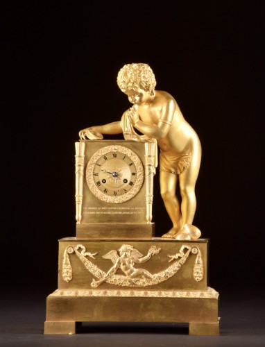 Antiquités - A French Louis Philippe mantel clock with a large putto, circa 1830