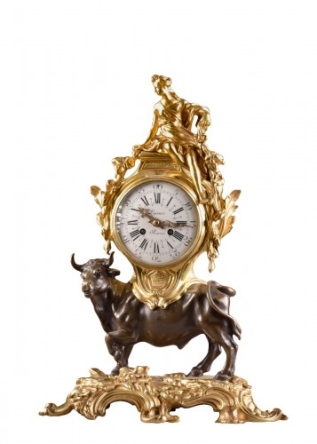 A mantel clock with a large horned bull circa 1850
