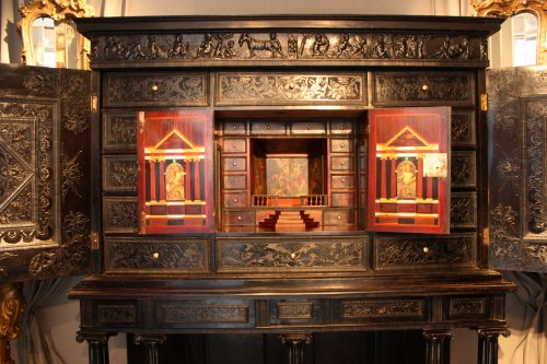 A 17th century carved ebony and ebonized wood cabinet, Paris -