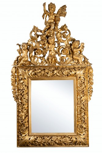 18th century Italian carved gilt wood mirror depicting four seasons