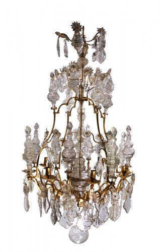 A Louis XV mid-18th c. gilt-bronze mounted crystal chandelier
