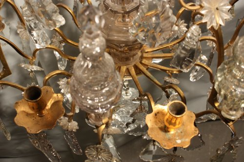 18th century - A Louis XV mid-18th c. gilt-bronze mounted crystal chandelier