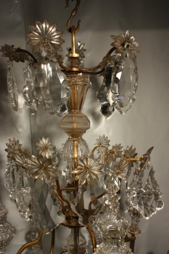 A Louis XV mid-18th c. gilt-bronze mounted crystal chandelier - Louis XV