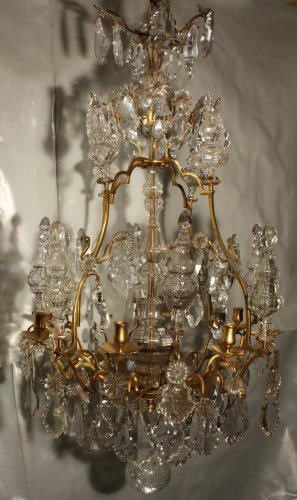 Antiquités - A Louis XV mid-18th c. gilt-bronze mounted crystal chandelier