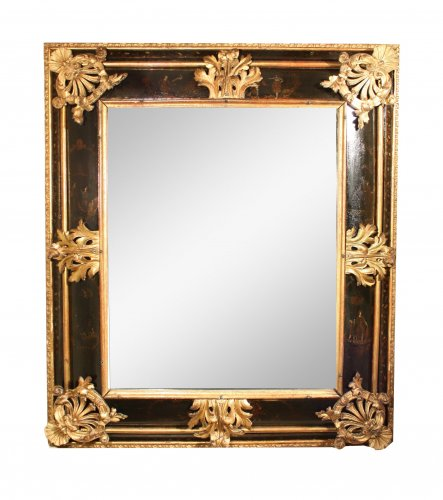 A late 17th c. Venetian lacquer and gilt wood mirror