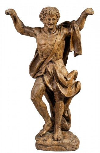 A large North European late Baroque carved oak figure of Atlas