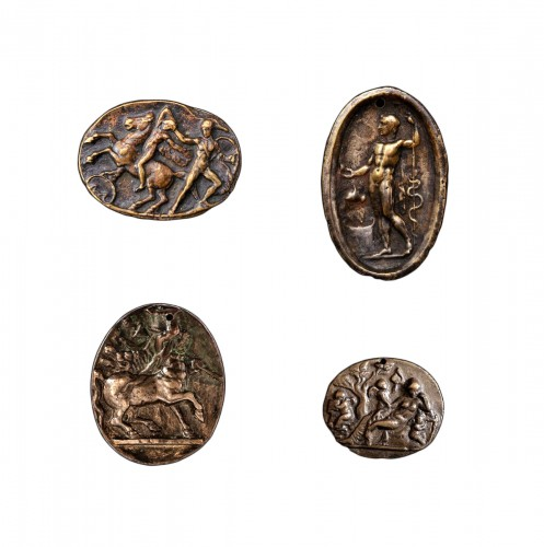 A collection of four 15th century all'antica bronze Italian plaquettes