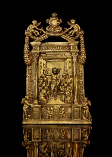 An elaborate gilt bronze pax of the Risen Christ dated 1557 -